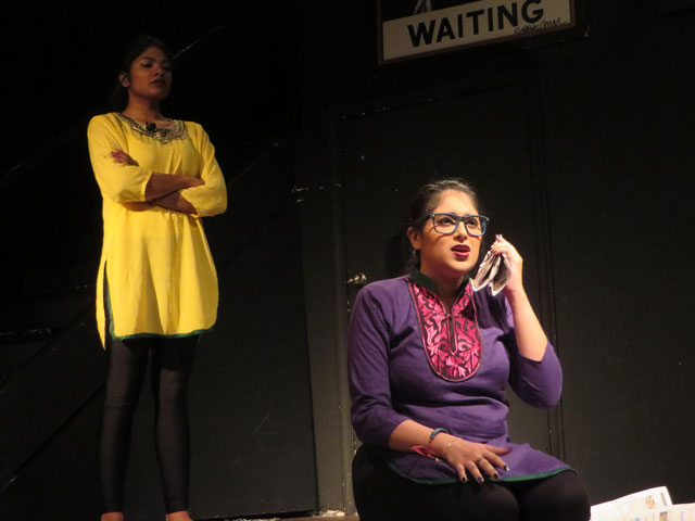 """Chenthoori (left) and Kathana (right) of Pomegranate Tree Group illustrate a painful struggle between a daughter and her family in the play """"When We Leave."""""""